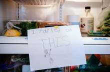 "Child Tapes """"I Farted On THIS"""" Sign On Food In Refrigerator"