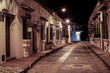 View to typical street with one story buildings at night in light of lanterns, Santa Cruz de Mompox, Colombia, World Heritage