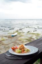 Sea Weed Salad Served In A Bar With Sea Weed Plantation View