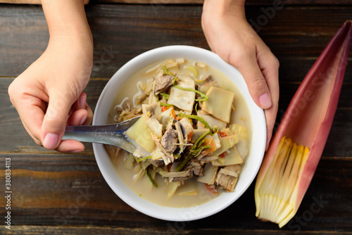 Northern Thai food (Kaeng Hua Plee), banana blossom spicy soup with pork in a bo Wallpaper Mural