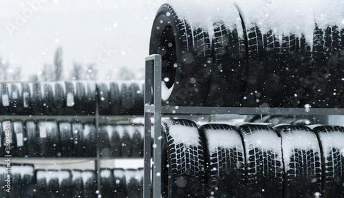 Tire and wheels shop on the street. Seasonal tire change. Fototapet