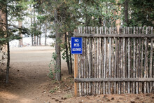 """No Pets Allowed"""""""" Sign On A Wood Fence"""
