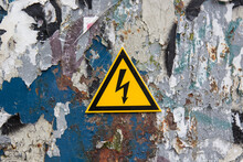 Electricity Sign On A Metal Door Covered With Paint Residue