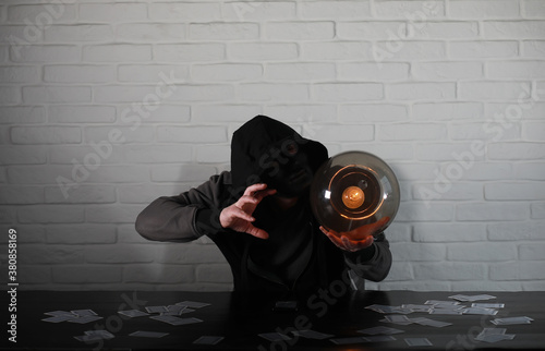 Vászonkép A man with a fortune teller ball