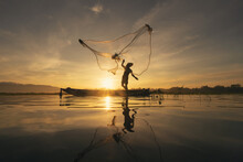 Silhouette Fisherman Casting O...