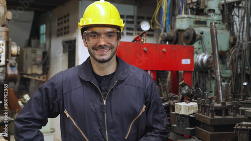 Fototapeta Young factory worker or engineer close up portrait in factory . Industry and engineering concept . obraz