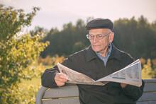 Elderly Man Wearing Cap And Gl...