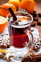 Hot Red Mulled Wine With Christmas Spices And Cookies, Orange, Anise And Cinnamon Sticks