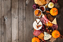 Fall Theme Charcuterie Side Border Against A Dark Wood Background. Selection Of Cheese And Meat Appetizers. Copy Space.