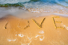 The Word LOVE Written On A Yel...