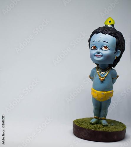 Cute and innocent toy idol of Hindu God Lord Krishna фототапет