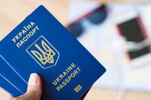Three Ukrainian Passports On T...