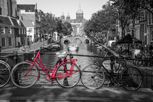 A Picture Of A Red Bike On The...