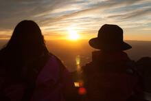Tourists In Brilliant Sunset F...