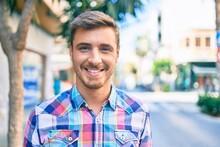 Young Caucasian Man Smiling Ha...
