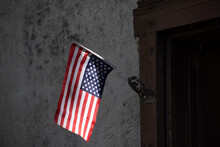 Upside-down American Flag In Front Of A Poor House As A Sign Of Political Distress, As Tensions Grow With The Approaching Presidential Election