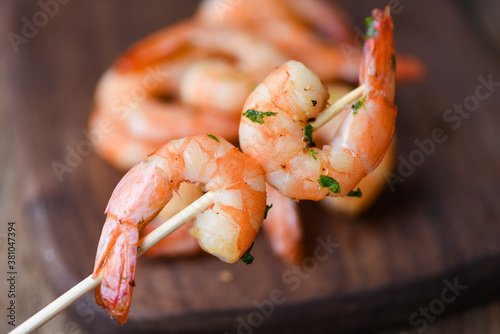 Fotografering Salad grilled shrimp skewers delicious seasoning spices appetizing cooked shrimp