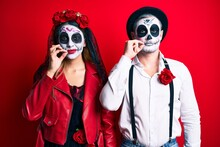 Couple Wearing Day Of The Dead...