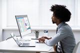 Analyst Employee Working With Spreadsheet