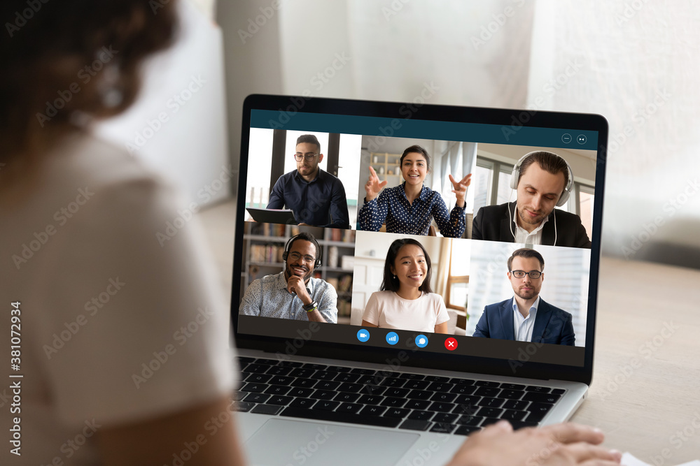 Fototapeta Close up view of woman talk on video call on laptop with diverse multiracial colleagues. Female employee have webcam conference or digital virtual communication with coworker. Online meeting concept.