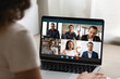 Close up view of woman talk on video call on laptop with diverse multiracial colleagues. Female employee have webcam conference or digital virtual communication with coworker. Online meeting concept.