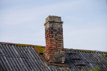 Roof With Old Brick Chimney