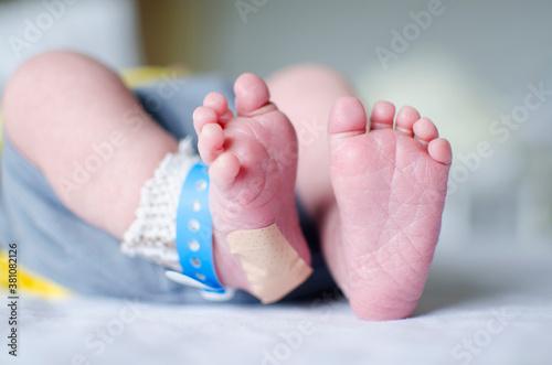 Obraz na plátně Newborn feet with heel test and band aid.