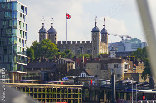 Obraz Tower of London with Union Jack flag and river bank buildings and promenade - fototapety do salonu