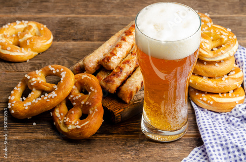 Oktoberfest food, bavarian pretzels with beer glass on old rustic wooden backgro Canvas Print