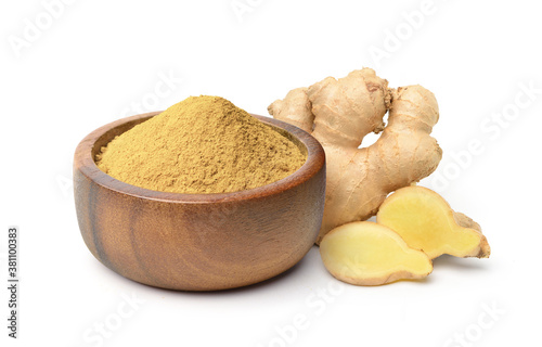 Obraz na plátně Finely dry Ginger powder in wooden bowl with  rhizome (root) sliced isolated on white background