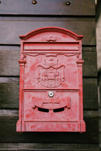 Red Metal Mailbox With A Patte...