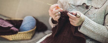 Asian Old Woman Knitting Crochet With Taplet At Home