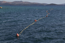 Rope With Buoys To Fence Off A...