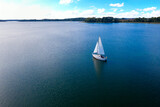 Aerial view of the yacht sailing on a Lubikowskie lake at perfect weather conditions in summer, Poland