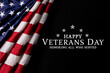 Happy Veterans Day. American flag on black background with text.