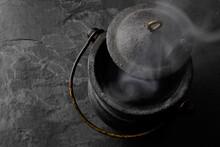 Smoking Black Iron Cauldron On...