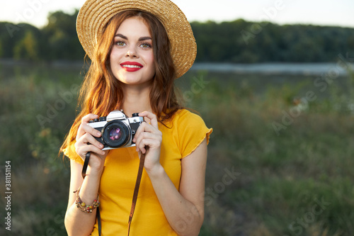 Fototapeta Pretty woman photographer in nature smile red lips attractive look obraz