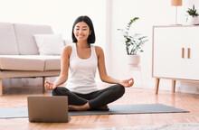 Millennial Woman Meditating Wi...