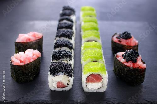 Fototapeta gunkan and maki sushi set decorated with caviar obraz