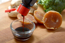 Poring Soy Sauce To Glass Bowl