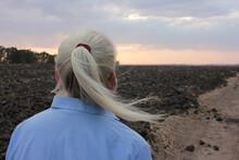 Back View Of Senior Blonde Wom...