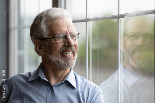 Happy mature grey-haired 70s man in glasses look in window distance dreaming or visualizing pleasant retirement Fototapet