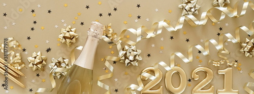 Happy new year 2021 decorations in gold colors on gold background. Banner.Top view. Christmas card.