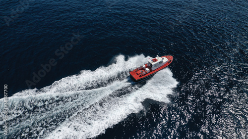 Leinwand Poster Aerial drone photo of red pilot boat cruising in high speed in Mediterranean dee