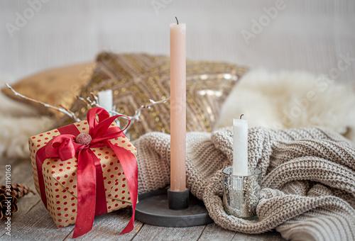 Slika na platnu Cozy festive still life with a gift and a candle