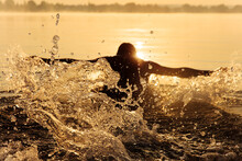 Strong Man In Silhouette Swimm...