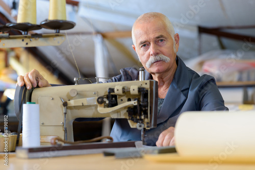 Canvastavla senior mechanic repairing industrial sewing machine