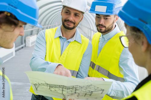 team of engineers studying a vital design Fototapet