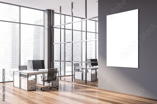 Obraz Vertical poster in modern gray open space office corner - fototapety do salonu