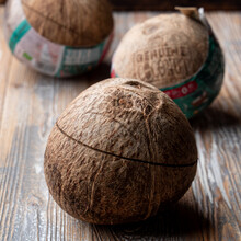 Three Closed Coconuts With Sta...